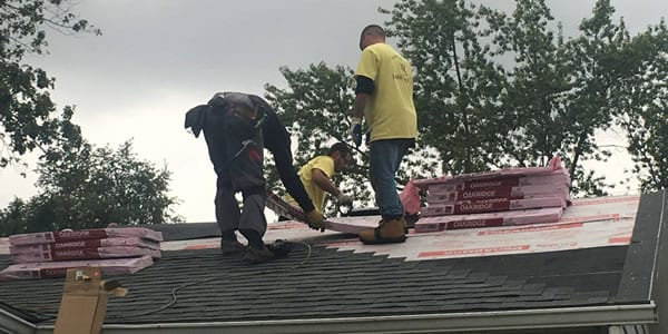 roofone working on roof leak 600 - Roof One Michigan. Greater Detroit Michigan Roofing Contractor